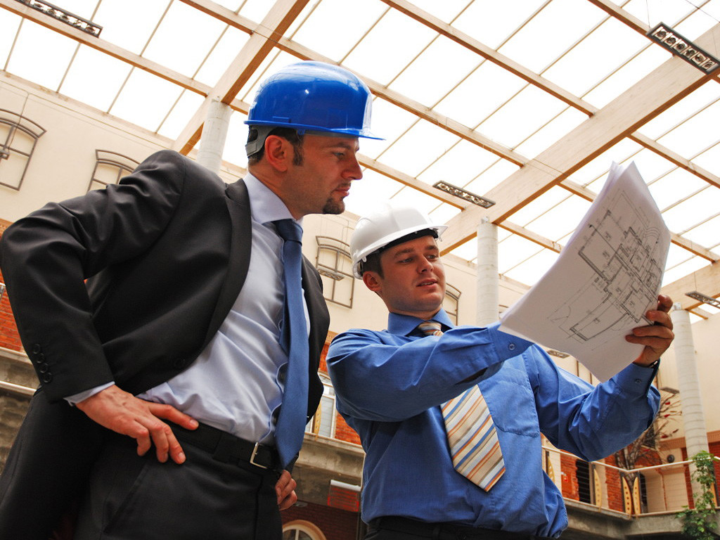 architect and supervisor  Reviewing Blueprints
